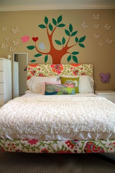 DIY Upholstered Headboard for Girl's Room, just add photos in bigger leaves on the tree for Rya!
