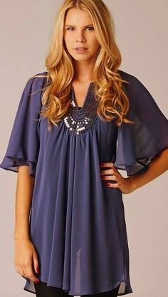Flowy tunic with sequin detail. Small fits a 0/2