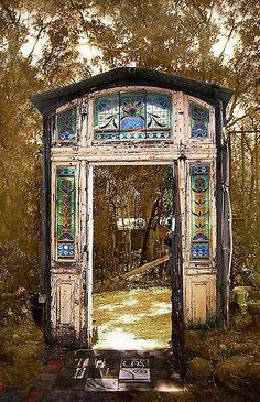 "using a salvaged door and frame between garden spaces to create outdoor ""rooms"""