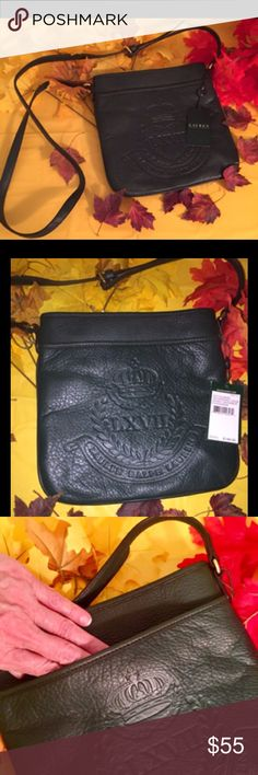Ralph Lauren Cross body Leather Bag NWT Ralph Lauren Cross body bag is done in evergreen  leather. It has a slip pocket on outside front and one inside too. There is an adjustable strap and the hardware color is gold. This bag basically has no depth, it's the type of bag to take shopping where you need the basics only I.e. keys, Id, cash and cards. Ralph Lauren Bags Crossbody Bags