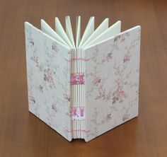 handmade notebook : floral motif, pink and white, combined stitching, coptic.