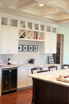 Cool wine bar, ceiling and kitchen. Jenny Steffens Hobick: Jill's Kitchen | White Marble, Stained Island, Cream Painted Glass Front Cabinets & Polish Silver Hardwar