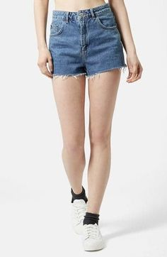 "Pin for Later: Kendall Jenner's Outfit Looks Simple Enough — Until You See Her Boots  Topshop ""Mom Jean"" Cutoff Shorts ($52)"