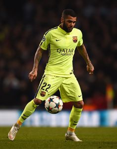 Daniel Alves of Barcelona in action during the UEFA Champions League Round of 16 match between Manchester City and Barcelona at Etihad Stadium on February 24, 2015 in Manchester, United Kingdom.