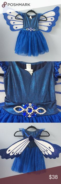 Blue Butterfly Costume By Chasing Fireflies, Wishcraft, size 4 Blue glitter butterfly. There are two blue teardrop gems missing from the inside of the wings, all gems are there on the outside of the wings. Dress in excellent condition. Wishcraft Costumes