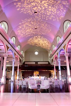 pink uplighting with three gobos projecting textured images on the ceiling. Goregous! #wedding #uplighting #gobo