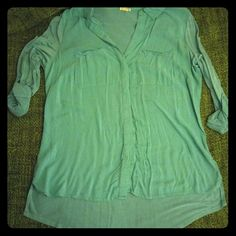 Converse Button-Up Turquoise button-up shirt by Converse with a slightly high-low hem and rolled 3/4 sleeves (full length when unrolled). Front of shirt is 100% rayon, back are sleeves are 95% rayon with 5% spandex. EUC. Converse Tops Button Down Shirts