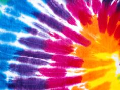Maybe have a tie dye theme (Born in the 60's) have people wear something that is tie dye.