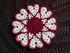 Just the Chrysanthemum Dishcloth  pattern cleverly worked into hearts. http://www.bernat.com/pattern.php?PID=4441