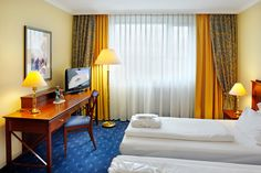 Blick in eines der Hotelzimmer / View into one of the hotel rooms   H4 Hotel Kassel