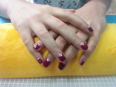 Classic red moonies on natural nails.