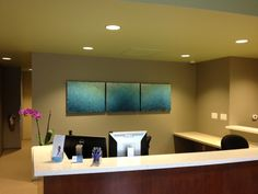 The vibrant colors and subtle movement in this piece contribute to a sense of calm in this healthcare facility.