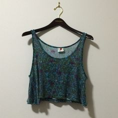 Free People Sequined Boxy Cropped Tank 100% viscose knit covered in clear sequins.  Excellent used condition. No flaws.  Boxy relaxed fit. Free People Tops Tank Tops
