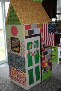 DIY cardboard playhouse. The kids can get in on the decorating too!