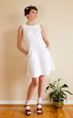 The 'Cecilia' white peter pan collar dress in soft hemp linen with pockets..