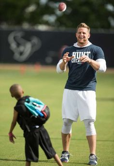 Though he's sidelined from practice, Texans star J.J. Watt is able to play catch with Jeston Adams, 8, whom he met through the Make-A-Wish Foundation. Photo: Brett Coomer, Staff / © 2016 Houston Chronicle