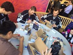 Kids & #LAKings' Williams, Stoll, & Lewis decorating TOMS #OneforOne boxes at Children's Hospital LA
