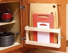 Innovative Kitchen Organization and Storage DIY Projects - Store cutting boards in a magazine rack on the interior of the door. Organisation Hacks, Kitchen Organization, Kitchen Storage, Cabinet Storage, Diy Kitchen, Kitchen Ideas, Organizing Ideas, Kitchen Small, Space Kitchen