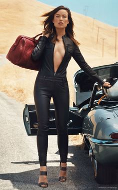 Leather-clad Olivia Wilde poses with a sports car. Hot wheels: Rush star Olivia Wilde posed with a classic sports car in the California desert during an Allure photo shoot for their October i Olivia Wilde, Auto Girls, Car Girls, Girl Car, Sexy Cars, Hot Cars, Sexy Autos, Norman Jean Roy, Up Auto