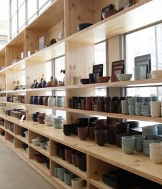 Basic, well-joined plywood shelves can really compliment ceramics, glass, or other objects. This image is from Health Ceramics in San Francisco, Cafe Display, Store Displays, Display Shelves, Shelving, Ceramic Store, Pottery Cafe, Plywood Shelves, Restaurants, Heath Ceramics