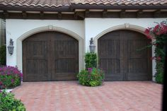 Our faux wood garage door is similar to Clopay Canyon Ridge faux wood garage doors. Faux wood garage doors at an affordable price. Shop around and then call us. Website: http://www.faux-wood-garage-doors.com or www.ranchhousedoors.com