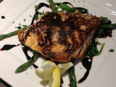 Pan seared salmon served over arugula, served with steamed asparagus and drizzled with balsamic reduction.