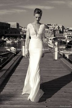 So beautiful and elegant...if I could get a second dress for the reception this would be it