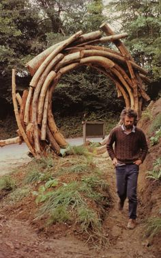 Outdoor wood log portal - art and awesome idea - imagine finding a secret garden beyond something like this! - curated by adam miller