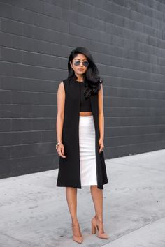 Layer with a crop top, pencil skirt, and pumps.