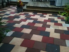 My back patio...  1.  Lay simple 12 x 12 cement stepping stones.  2.  Paint each stone in a random pattern with any latex paint (I used a brick red, chocolate, beige, and black).  3.  Paint entire area with an antique brown glaze.