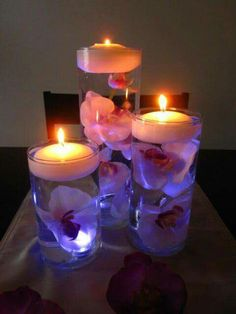 Lit up trio of floating candle centerpieces