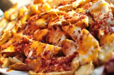 Cheesy Potato Fries: {NOT HEALTHY} 6Potatoes, 1/4C Oil, Salt & Pepper, 1C Sour Cream, 1/2C Ranch Dressing, 1/4C Milk, 1C Cheddar, 1/2C Mozzarella, 1/2C Bacon Bits, 1/4C Scallions. Cut Potatoes into Steak Fries. Place on Baking Sheet, Drizzle w/Oil & Seasoning. Bake 400F for 40Mins. In Bowl mix Sour Cream, Ranch & Milk. On platter smooth out 3/4 of Sour Cream Sauce. Place Potatoes on Top. Drizzle Sour Cream Sauce on Potatoes, Sprinkle Toppings. Broil 1Min.