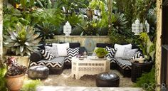 Moroccan outdoor oasis. Check out the Moroccan lanterns, mashrabiya coffee table, leather poufs. Elle Decor November 2012