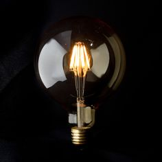 G125 Filament Bulb  A stylish LED that will really light up the room.  Comes in a 4 Filament 3W version or an 8 Filament 6W version for something a little brighter - both also come in a tinted or smoked glass to add a little more ambience.  Photo is a 6W smoked glass.  www.vintageled.com.au
