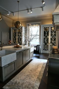 overall design ...tone/palette similar to ours. End cabinets, pendants, runner ............Habitually Chic®