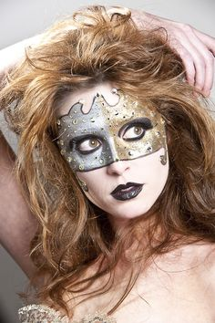 Golden crystal accented make-up mask.