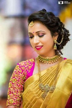 South Indian bride. Gold Indian bridal jewelry.Temple jewelry. Jhumkis.Gold silk kanchipuram sari with contrast pink blouse.Braid with fresh jasmine flowers. Tamil bride. Telugu bride. Kannada bride. Hindu bride. Malayalee bride.Kerala bride.South Indian wedding.
