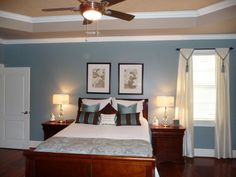 Love the dark furniture and light colored bedding.  Wall color is Valspar Cafe Blue.