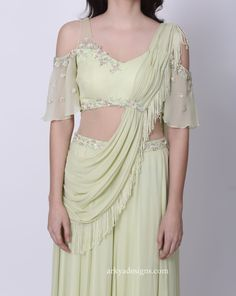This is a chiffon palazzo saree with attached drape and tassels and floral embroidery on the the blouse and belt Indian Bridal Outfits, Indian Designer Outfits, Suits For Women, Clothes For Women, Half Saree Designs, Stylish Sarees, Blouse Neck Designs, One Piece Dress, Saree Styles
