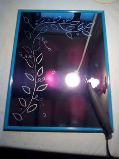Paola Brunetti incisioni su vetro:  Specchio che ho inciso a mano, con rami con fogli...