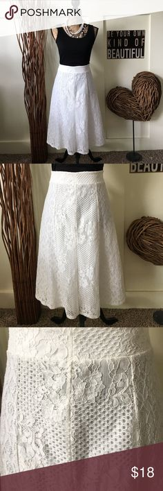 Beautiful lined white lace skirt This beautiful white lace skirt is fully lined with a wide waistband and a zippered back closure.  length from waste to hem is approximately 27 inches Cato Skirts Midi