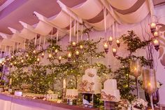 desserts and cakes table for weddings in gold and beige