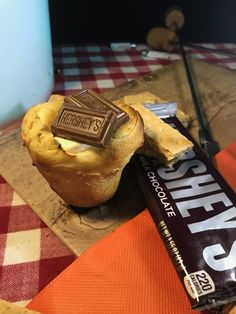 It is a campfire treat that is made from refrigerated biscuit dough and filled with yummy treats that you create. Camping Snacks, Yummy Treats, Biscuits, Muffin, Chocolate, Breakfast, Food, Camp Snacks, Morning Coffee