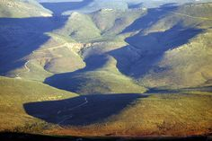 The Karoo mountains, near Bushmans Kloof, are an amazing sight just after the rain season. 5 Star Spa, Homeland, Roads, Wilderness, Landscape Paintings, South Africa, Curvy, Hotels, Mountains