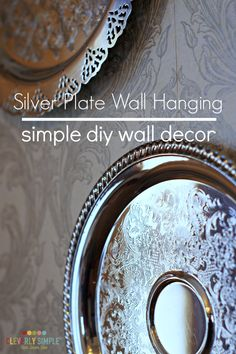 Grab a couple of silver plates for very cheap and make this seriously easy simple diy wall decor! It will dress up any wall.