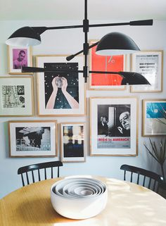dining room gallery wall - same frames, colorful art