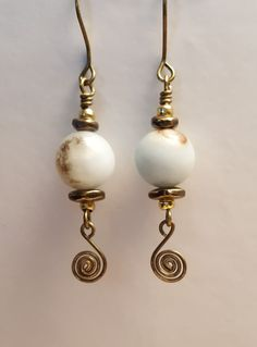 Natural stone with swirl dangles.