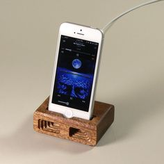 Acoustic iPhone 5 dock in Mahogany - Amplifies sound through unique acoustical pockets .. $34.50, via Etsy.