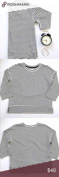 """Lou & Grey Dohlman Sleeve Striped Top Cute black and white striped top from Lou & Grey by LOFT! This top is dohlman sleeves, 3/4 length and has a wider sleeve! Cute for spring! No holes or stains! Measurements laying flat: armpit to armpit 20"""", length: 25.5"""". Materials and care tag shown. Size Small. Lou & Grey Tops Blouses"""