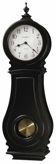 <p> This worn black wall clock features a turned finial and antique spun brass pendulum. The Antique white dial offers black Arabic numerals and spade hands. Finished in Worn Black on select materials, hardwoods and veneers. Swinging pendulum. Quartz, dual chime movement plays Westminster or Ave Maria chimes, and features volume control and automatic nighttime chime shut-o...